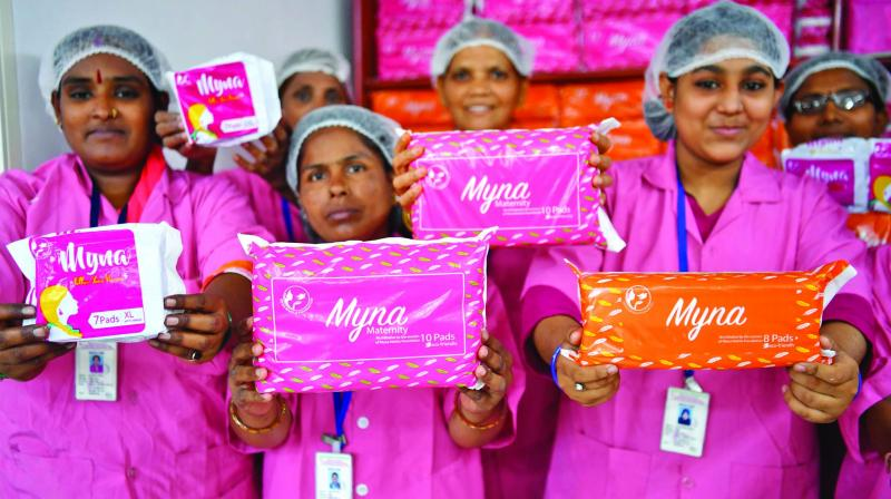 Myna Mahila Foundation workers holding their products