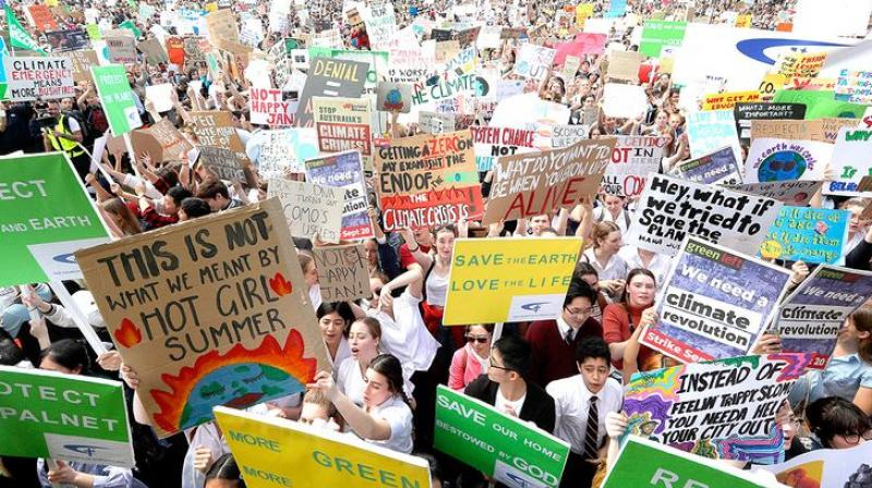 Large-scale agitations first started in Australia on Friday, setting things in motion with close to 3,00,000 people coming out on the streets in 'the land Down Under' for the cause of global warming. (Photo: AP)