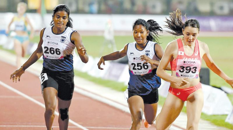 Swapna Barman (centre) en route to her gold in the women's heptathlon event in the Asian Athletics Championships at the Kalinga Stadium in Bhubaneswar. (Photo: PTI )