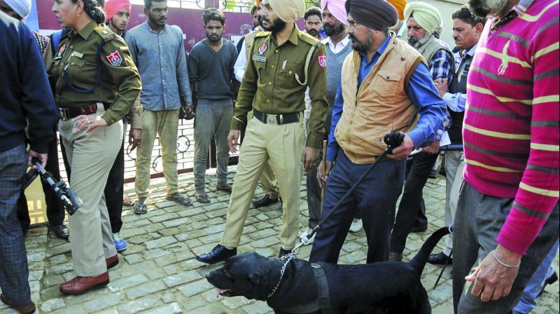 Police personnel inspect the site of a blast at the Nirankari Bhavan in Adliwal village near Amritsar. (Photo: PTI)