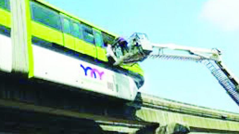 A file photo of commuters being rescued from the monorail near Mysore Colony station on November 9, 2017.