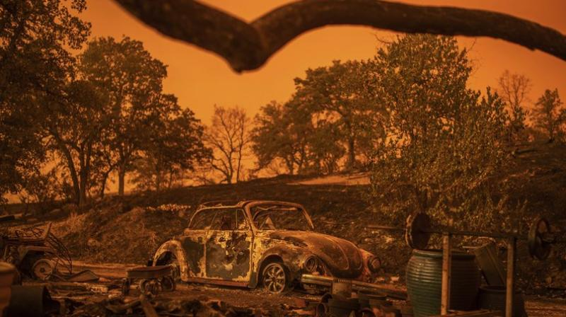 Cars scorched by the Carr Fire rest at a residence in Redding, California on July 27. (Photo: AP)