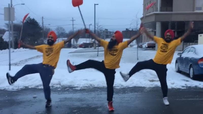 The group dances to a typical bhangra beat with shovel in hand. (Photo: Youtube)