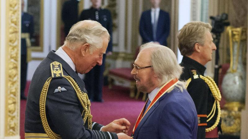 Singer and songwriter Barry Gibb talks with Prince Charles, left, during an Investiture ceremony to award a knighthood to Gibb, at Buckingham Palace in London, Tuesday June 26, 2018.  (Photo: AP)