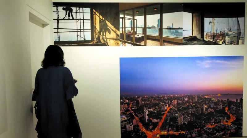 A visitor looks at Pallon Daruwalla's photographs