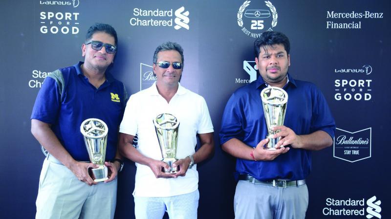 Satish Cheeti, Murad Talib and Sahil Jain pose with their trophies