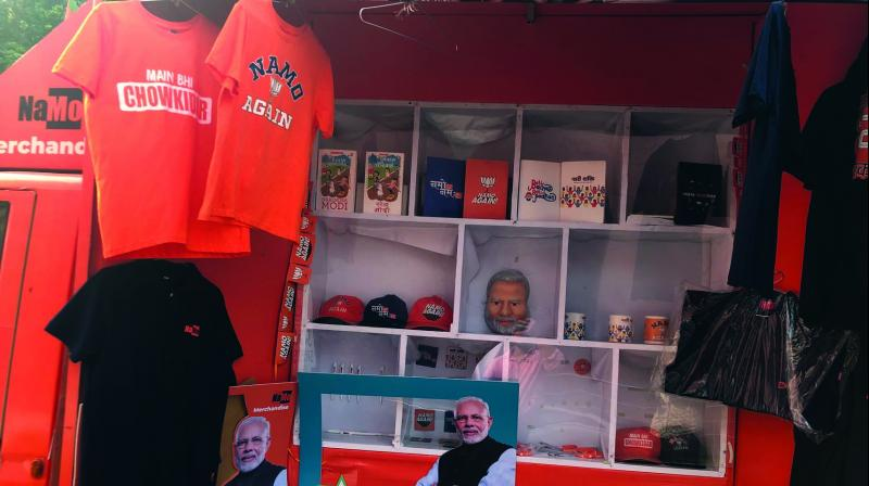 Pagdi, T-shirts, caps, pens, badges, mugs, and masks embellished with catchy messages are on sale and likely to attract the public.