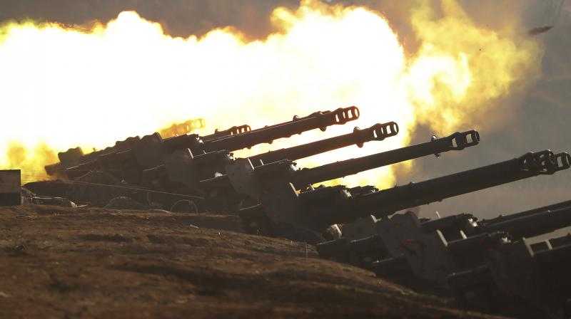In this photo provided by the North Korean government, an artillery firing competition between army units is held in the country's west in North Korea. AFP Photo