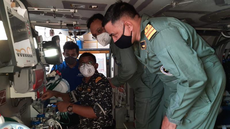 Navy personnel on-board ALH Mk-III. (Photo: Twitter/@DefPROMumbai)