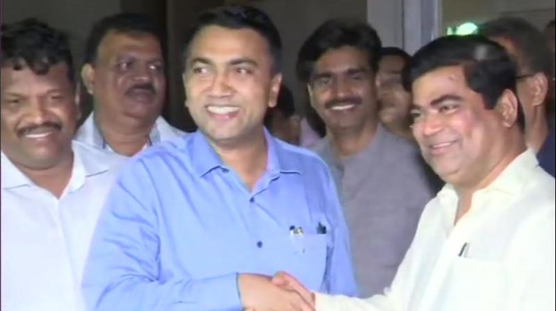 Goa CM Pramod Sawant with the incumbent Leader of Opposition Chandrakant Kavlekar. (Photo: ANI)