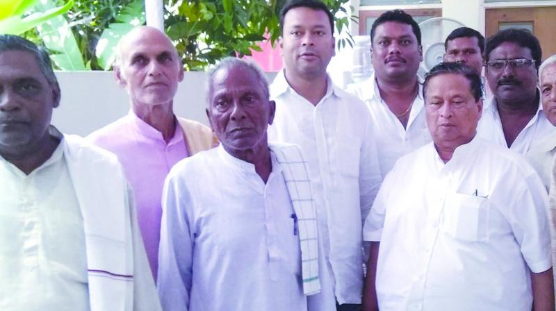 Odisha Pradesh Congress president Niranjan Patnaik (right) with party workers.