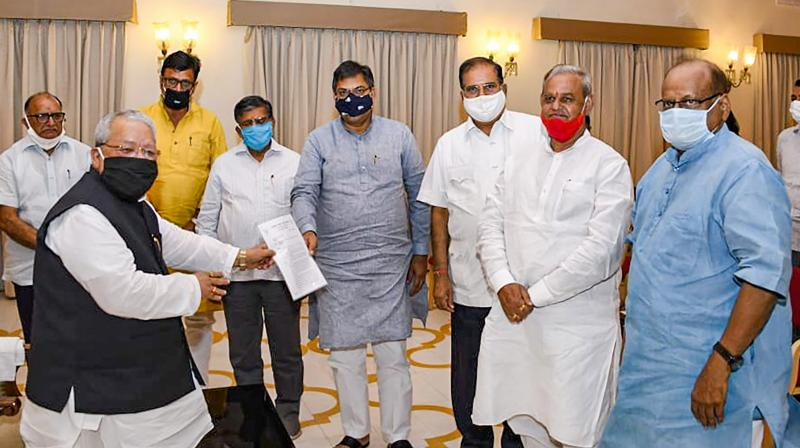 BJP delegation led by State Party President Satish Poonia and Leader of Opposition Gulab Chandra Kataria submit a memorandum with Governor Kalraj Mishra, at Raj Bhawan in Jaipur. PTI photo