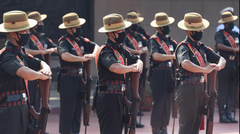 Soldiers pay tribute to the martyrs of Kargil war on the occasion of Kargil Vijay Diwas, at National War Memorial in New Delhi. PTI photo