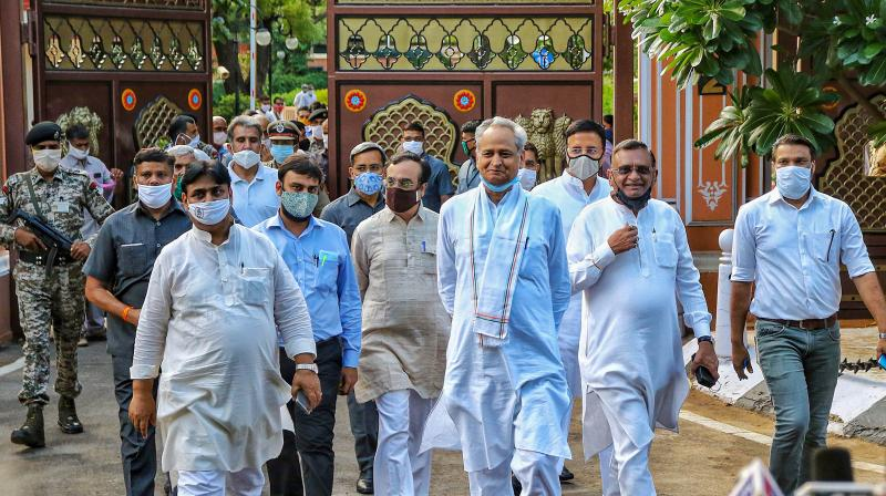 Rajasthan Chief Minister Ashok Gehlot along with senior Congress leaders and MLAs arrives to address media outside Raj Bhawan, in Jaipur. PTI photo
