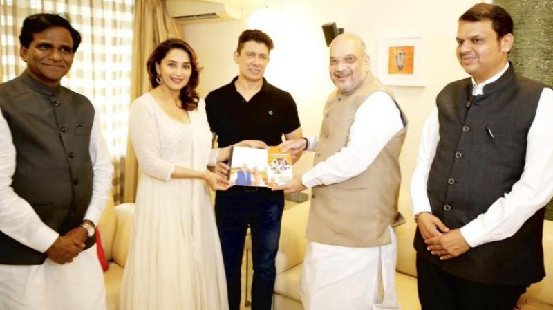 51-year-old actor, Madhuri Dixit has featured in many Bollywood films, including 'Hum Aapke Hain Koun..!', 'Dil To Pagal Hai', 'Saajan' and 'Devdas'. (Photo: Twitter | @AmitShah)