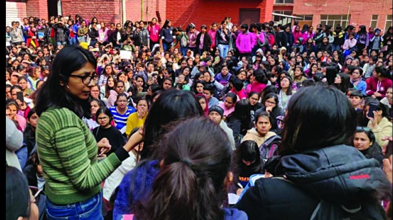 DCW chief Swati Maliwal visits Gargi College during a protest orgainsed by girl students against the alleged molestation incident happened recently, in New Delhi on Monday. (Photo: Asian Age)