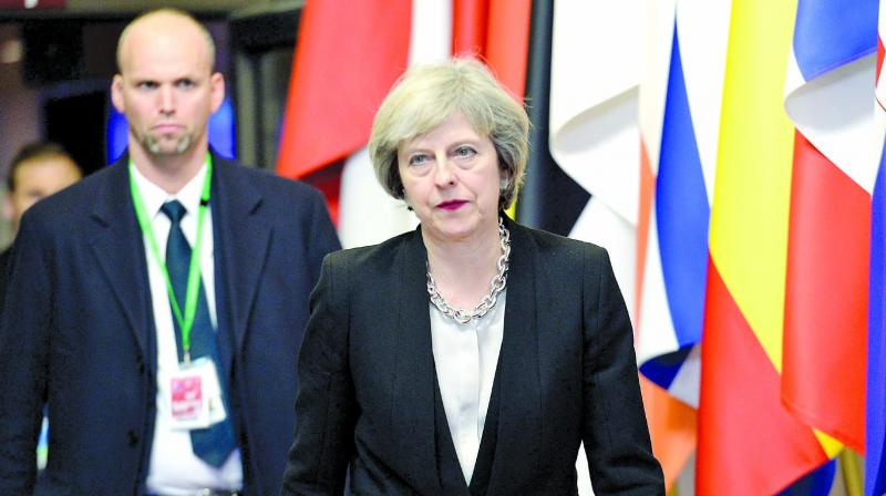 British Prime Minister Theresa May leaves at the end of the European Union Summit at the EU Council building in Brussels on Thursday. (Photo: AFP)