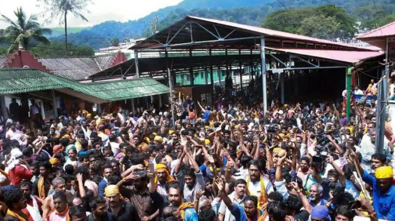 Protests erupted in Sabarimala temple in Kerala's Pathanamthitta on Tuesday after a woman reached near the 18 holy steps of the hilltop shrine and agitators heckled her over her age. (Photo: PTI)