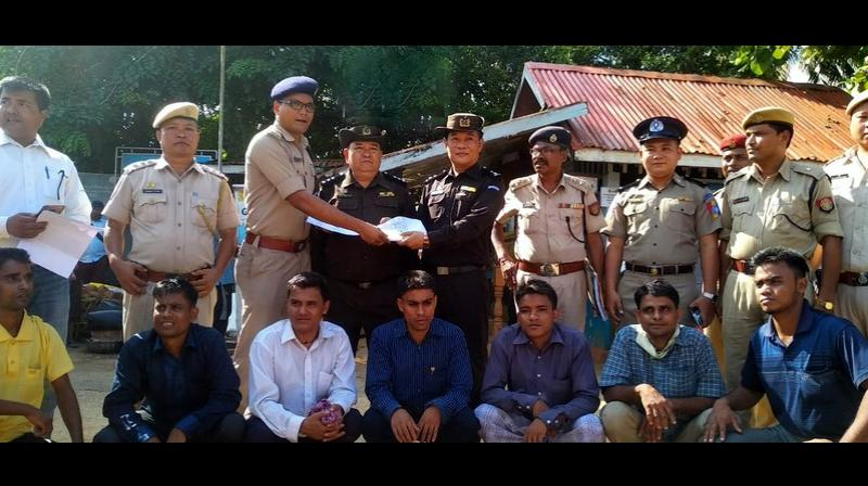 Assam Police hands over the 7 Rohingyas to Myanmar authorities after deportation formalities were completed. (Photo: Twitter | ANI)