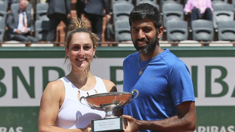 Playing only his second Grand Slam final, Rohan Bopanna and Gabriela Dabrowski saved two match points to eke out a memorable 2-6 6-2 12-10 win over Germany's Anna-Lena Groenefeld and Colombia's Robert Farah.(Photo: AP)