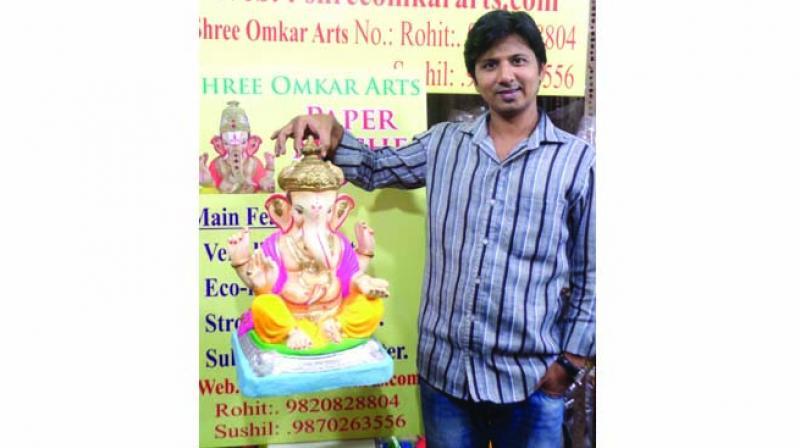 Rohit Vaste with his paper ganesha idol
