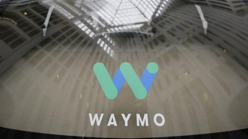 Waymo is rolling out amenities to entice riders to use its self-driving taxis, creating a potential route to profitability in a money-losing industry.