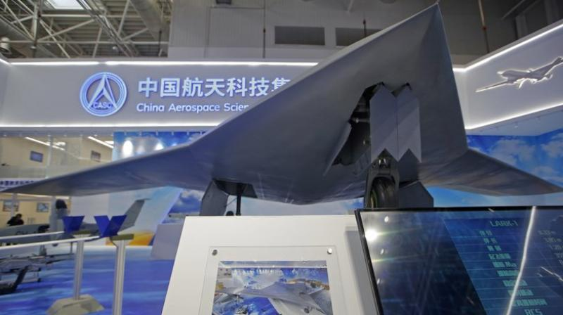 "The CH-7′s chief designer Shi Wen says the aircraft can ""fly long hours, scout and strike the target when necessary."" (AP Photo/Kin Cheung)"