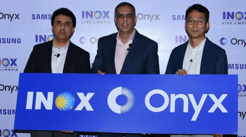 Seen from Right to left Mr. Puneet Sethi, Vice President, Consumer Electronics Enterprise Business, Samsung India, Mr. Alok Tandon, Chief Executive Officer, INOX Leisure Limited. and Mr. SH Jang, Director Consumer Electronics Enterprise Business, Samsung India.