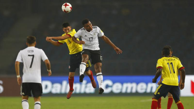 Germany's Maurice Malone (right) and Colombia's Fabian Angel in action in their Fifa Under-17 World Cup round of 16 match in New Delhi on Monday. Germany won 4-0. (Photo: AP)