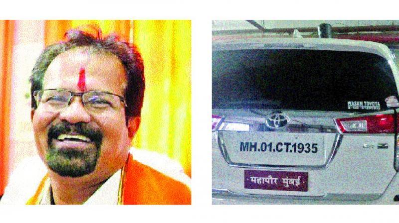 Mumbai mayor Vishwanath Mahadeshwar and his official car (right) that still sports a red beacon.