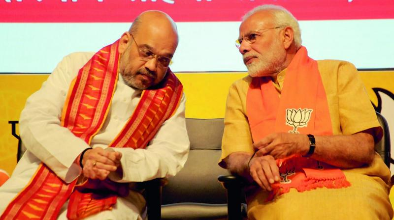 Prime Minister Narendra Modi and BJP president Amit Shah at the National Executive Committee meeting of the party's all wings (morchas) at Civic Centre in New Delhi. (Photo: PTI )