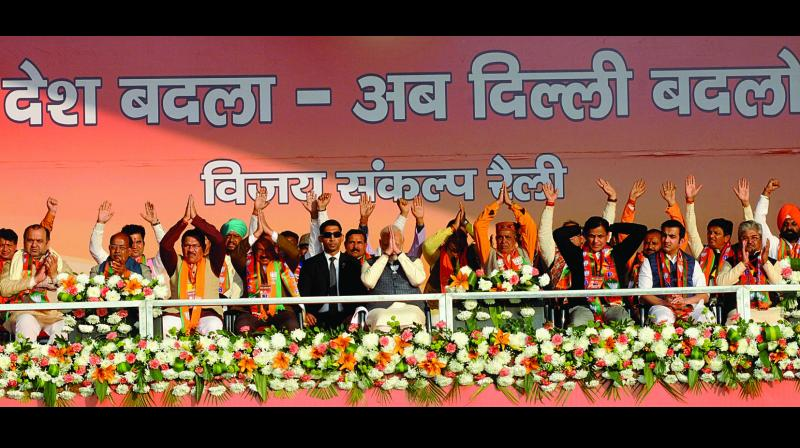 Prime Minister Narendra Modi with all 20 candidates from East and North-East Delhi seats during a rally at Karkardooma ground in New Delhi on Monday. (Photo: G.N. JHA)