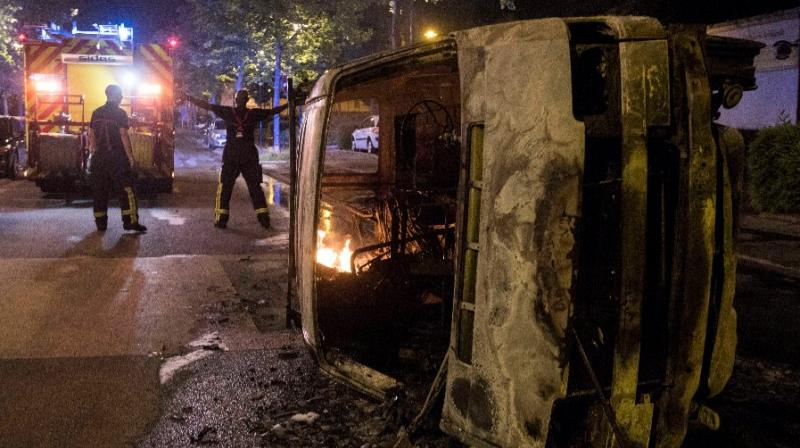 Fifty-two cars were torched overnight in Nantes, including the mayor's personal vehicle, and eight buildings were damaged by fire or vandalism. (Photo: @AFP/Twitter)