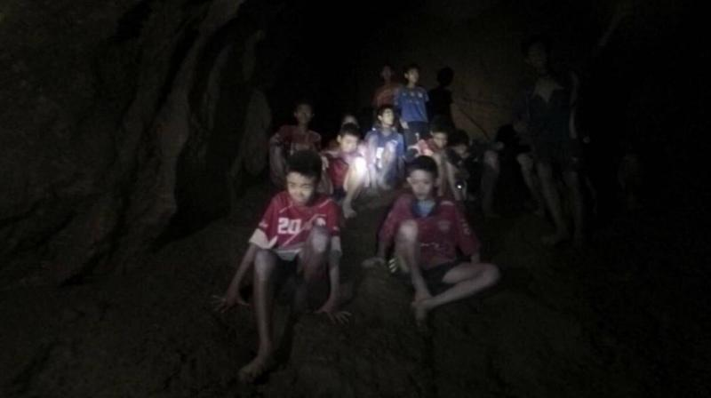 The players remain trapped despite being reached this week by cave-diving rescuers, who released footage of them looking emaciated but calm, some wearing football shirts. (Photo: AP)