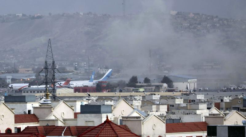 Smoke rises from a deadly explosion outside the airport in Kabul, Afghanistan. (Photo: AP)