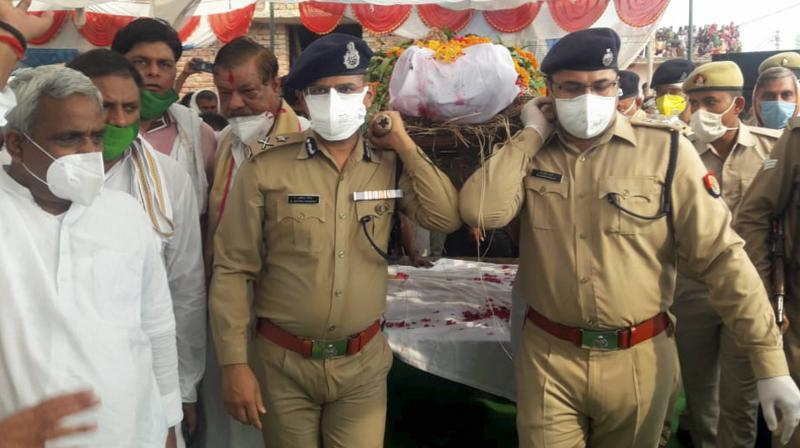 UP Police personnel carrying the last remains of one of their fallen. (PTI)