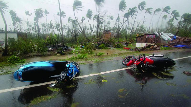 Motorcycles lie on a street in Puri after Cyclone Fani hit Odisha on Friday. (Photo: AP)
