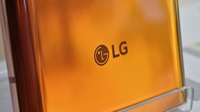 The logo of LG Electronics is seen on the back side of LG Velvet smartphone displayed at a telecom shop in Seoul on April 5, 2021. (AFP)
