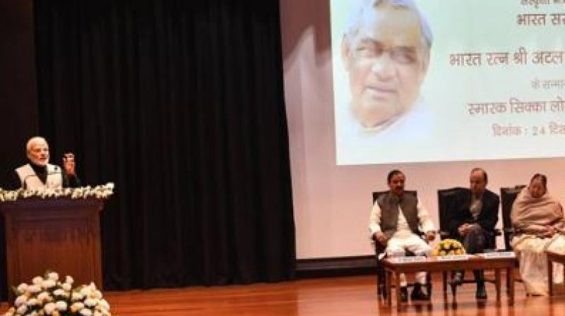 Releasing a Rs 100 commemorative coin in the memory of former prime minister Atal Bihari Vajpayee on the eve of his 94th birth anniversary, PM Modi said the late prime minister spent most of his political life in the opposition benches but always thought of the country and its people. (Photo: Twitter | @PIB India)