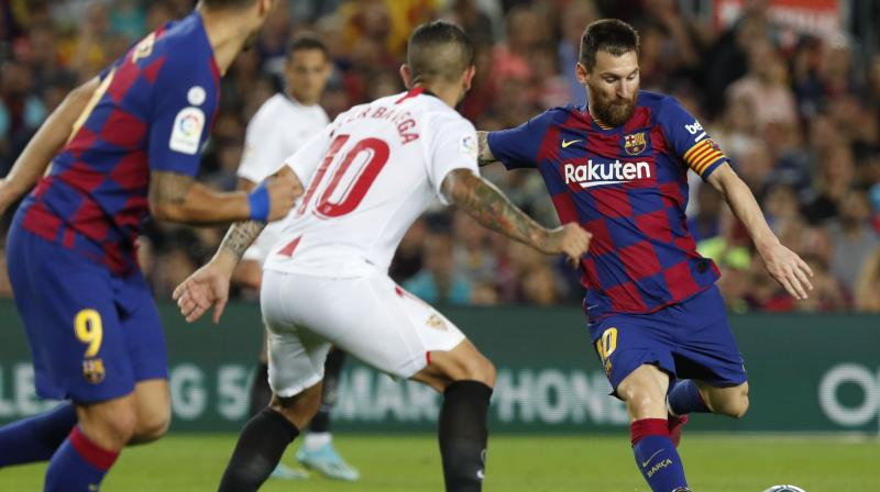 Lionel Messi scored his first goal of the season as Barcelona beat Sevilla 4-0 on Sunday to climb into second place in the La Liga standings behind Real Madrid. (Photo:AP)