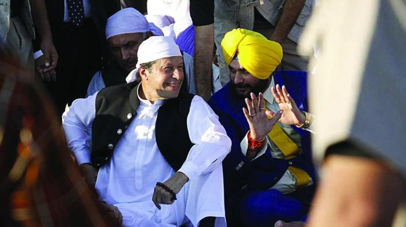 Pakistan's PM Imran Khan with Congress leader  Navjot Singh Sidhu in Kartarpur on Saturday.