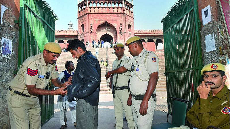 Security personnel keep vigil outside Jama Masjid in Delhi on Saturday. (Photo: PTI)