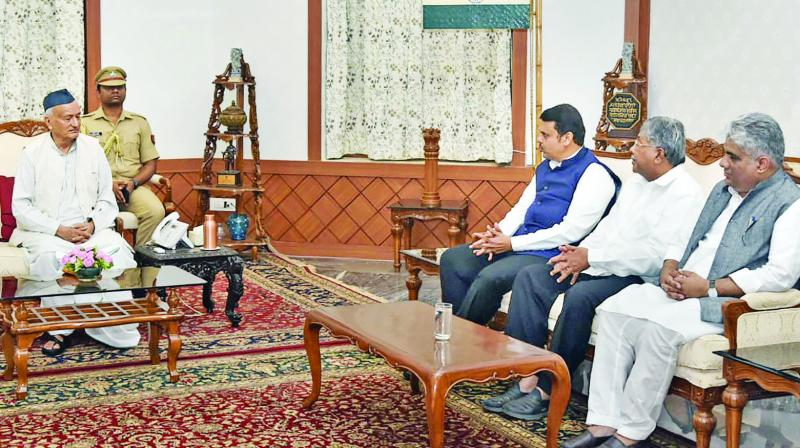Former Maharashtra chief minister Devendra Fadnavis with state BJP president Chandrakant Patil meet governor Bhagat Singh Koshyari in Mumbai on Sunday. (Photo: PTI)
