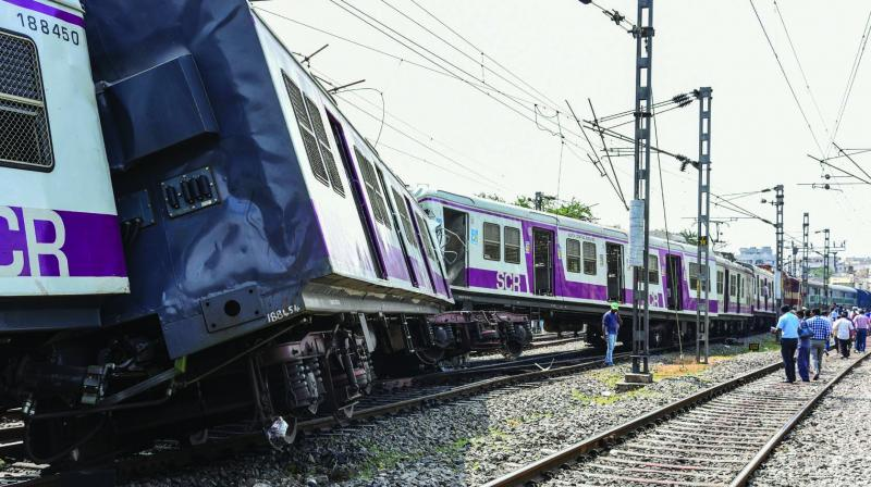 Onlookers gather at the accident site where a Multi-Modal Transport System train collided with a passenger train between Kacheguda and Malakpet stations in Hyderabad on Monday. An injured passenger (inset) is taken to a hospital for treatment. (Photo: PTI)