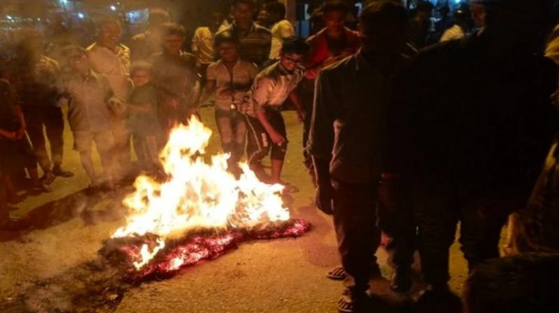 Chinese President Xi Jinping's effigy was burnt on Monday during a protest against Beijing for encroaching upon a chunk of Nepal's land. (Photo: ANI)