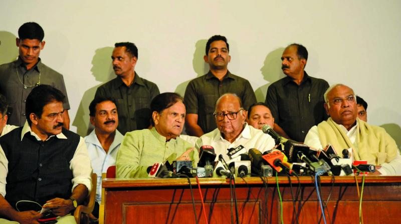 NCP leader Sharad Pawar and senior Congress leaders address a joint press conference in Mumbai on Tuesday. (Photo: Rajesh Jadhav)