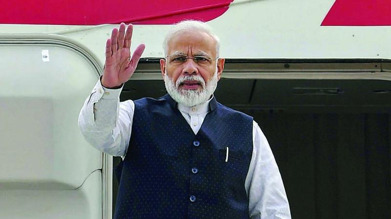 PM Modi emplanes for Brazil to take part in BRICS Summit in New Delhi onTuesday. (Photo: PTI)