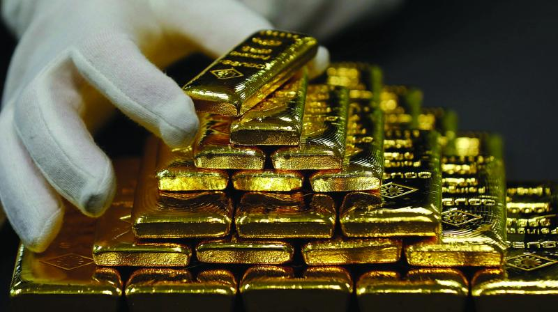 In the international market, gold traded higher at USD 1,458 per ounce.