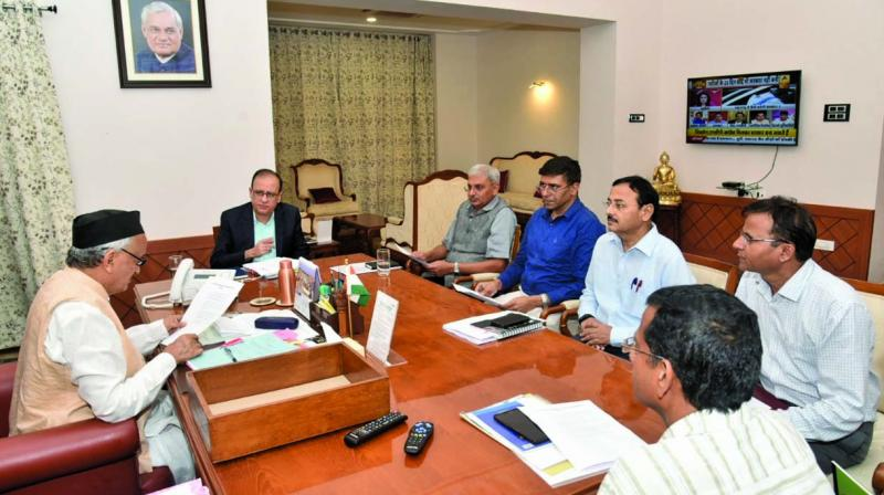 Governor Bhagat Singh Koshyari meets officials to take stock of the farmer crisis in the state on Saturday. (Photo: ASIAN AGE)