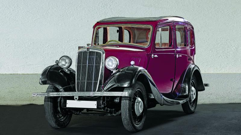 The Morris 8, with its four-door saloon and sunroof and the iconic chrome-plated radiator, has a Victorian-era vibe, whereas the Pontiac has an early racecar look to it.